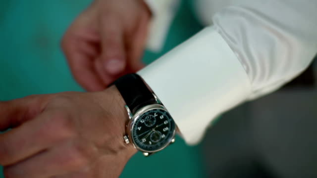 A man arranging his watch video