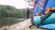 Man at campground fishing in lake video