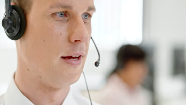 TU Man at the call center making a call to customer video