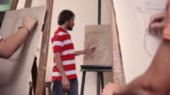 Man At Work As Teacher In Art School With Students video
