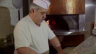 Man At Work Chef Making Pizza In Italian Restaurant Kitchen video
