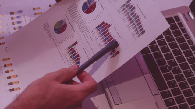 man at work in the evening, analyse expenses charts video