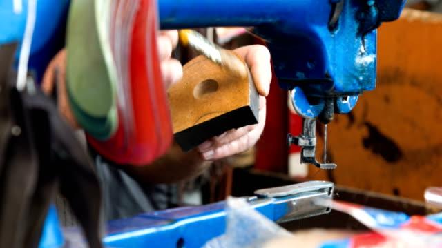 Man At Work Repairing Shoe video
