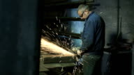 Man at work with circular blade in steel factory video