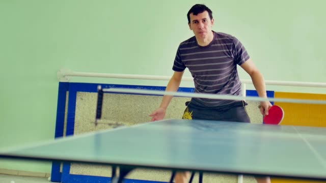 man athlete playing sport table tennis slow motion video backhand video