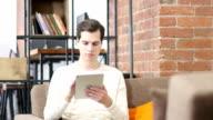 Man banker is searching information in the financial market via digital tablet video
