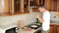 Man Beats Meat By Kitchen Hammer, funny guy dancing and preparing food video