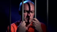 Man behind bars reflecting on his crime video