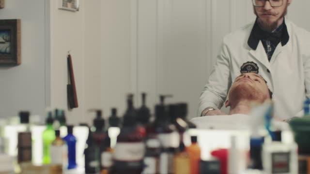 Man being prepared for haircut video