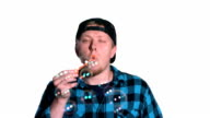 Man blowing bubbles is punched in face, slow motion video
