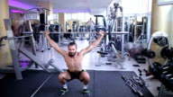 man bodybuilder with a bar exercises the biceps video