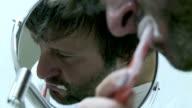 HD: Man Brushing His Teeth video