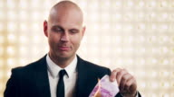 Man burning Money video