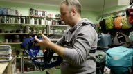 Man buys outfit alpinist climber mountaineer tools video