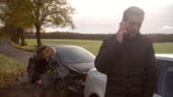 Man Calling To Report Car Accident On Country Road video