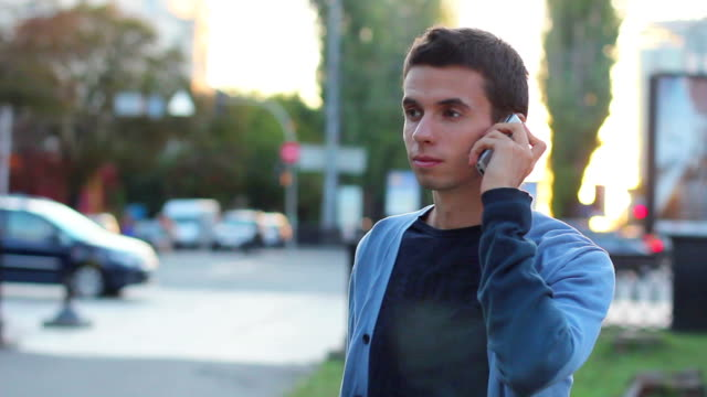 Man calls dials number no answer serious young male outdoors video