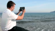 Man captures image with tablet video