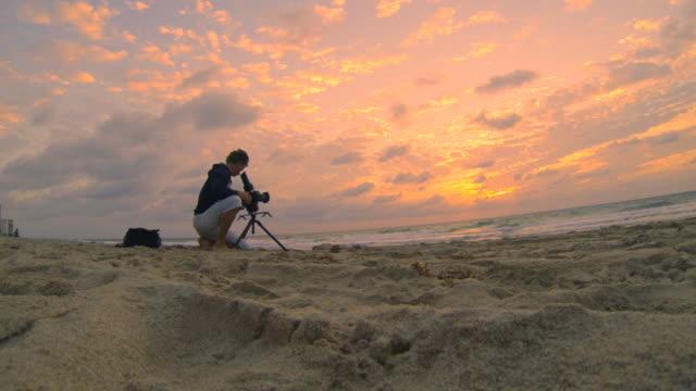 HD: Man Capturing Footage Of A Sunrise video