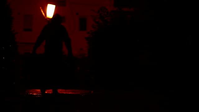 Man Carrying Bag in the Dark video