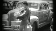 (1940's 8mm Vintage) Man Carrying Packages Across Parked Cars video