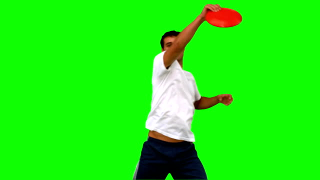 Man catching a frisbee on green screen video