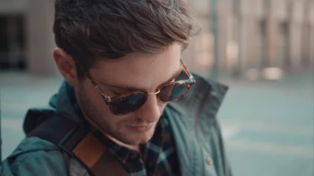 Man checking phone in urban setting video