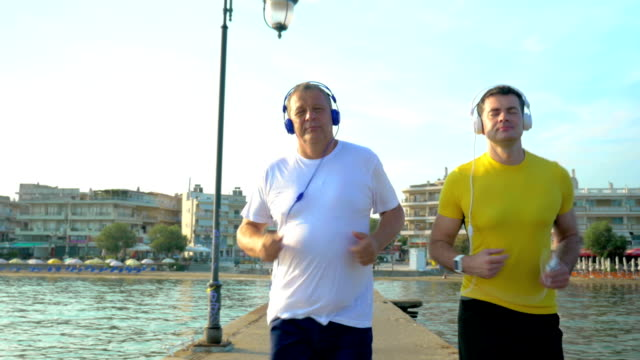 Man Checking Smart Watch during Morning Jogging video