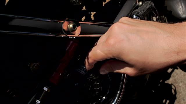 Man checks oil in his motorbike. video