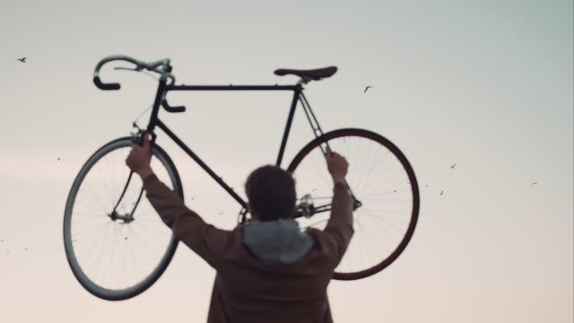 Man cheering with bike video