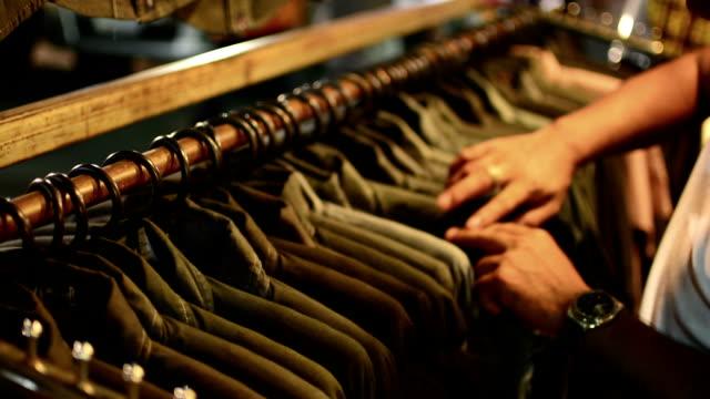Man choose a clothing. video