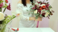 Man Chooses A Bouquet In Flower Shop video