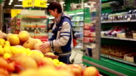 Man chooses a melon for buy in grocery store. 1920x1080 video