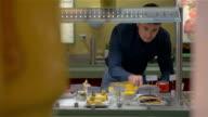 Man Choosing Bakery in Self-Service Buffet video