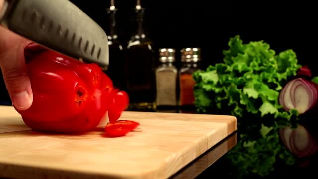 Man chopped red bell pepper video