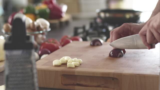 Man chopping red onion video