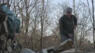 Man chopping wood slow motion video