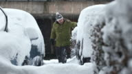 HD: Man Cleaning A Car Buried In Deep Snow video
