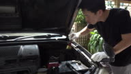4K : Man cleaning car engine video