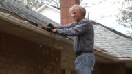 Man Cleaning Gutter video