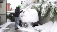 Man cleaning snow off his car video