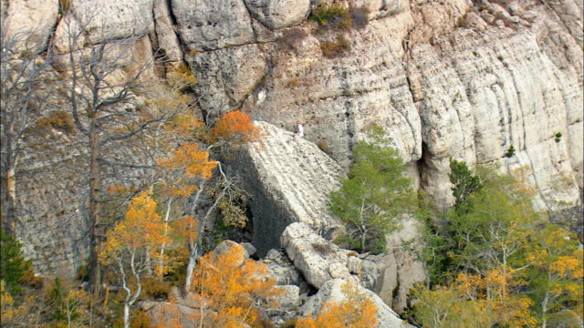 Man Climbing Rocks at Sinks Canyon - Aerial View - Wyoming, Fremont County, United States video