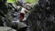 Man climbs a rock wall video