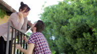 man climbs up to the balcony for  kiss the woman he loves video