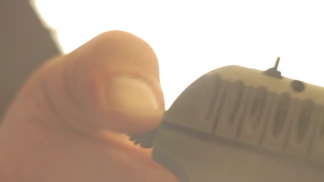 Man cocks the gun close-up video