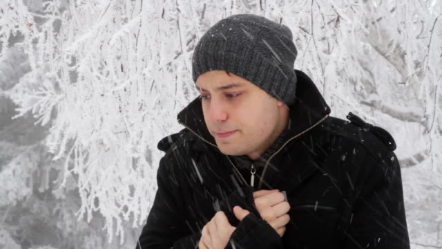 Man Cold Winter Outdoors Freezing Weather Snow Falling video