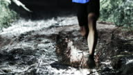 TD Man competing in night trail run running across puddle video