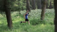 SLO MO DS Marathon runner competing on forest trail video