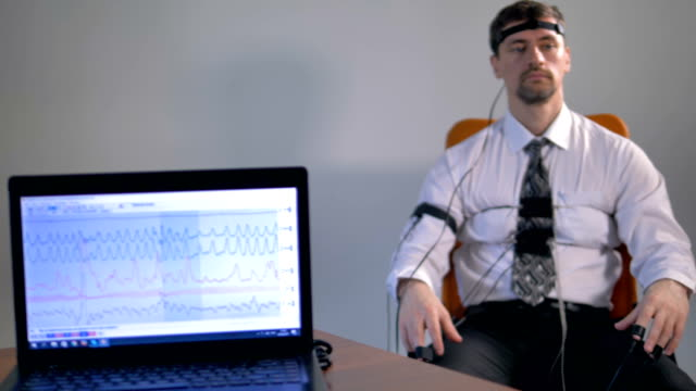 Man connected at polygraph. 4K. video