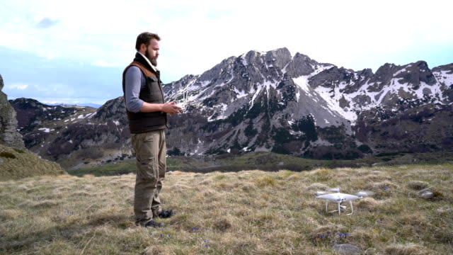Man controls the drone outdoors video