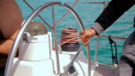 Man controls the steering wheel of a sailing boat video